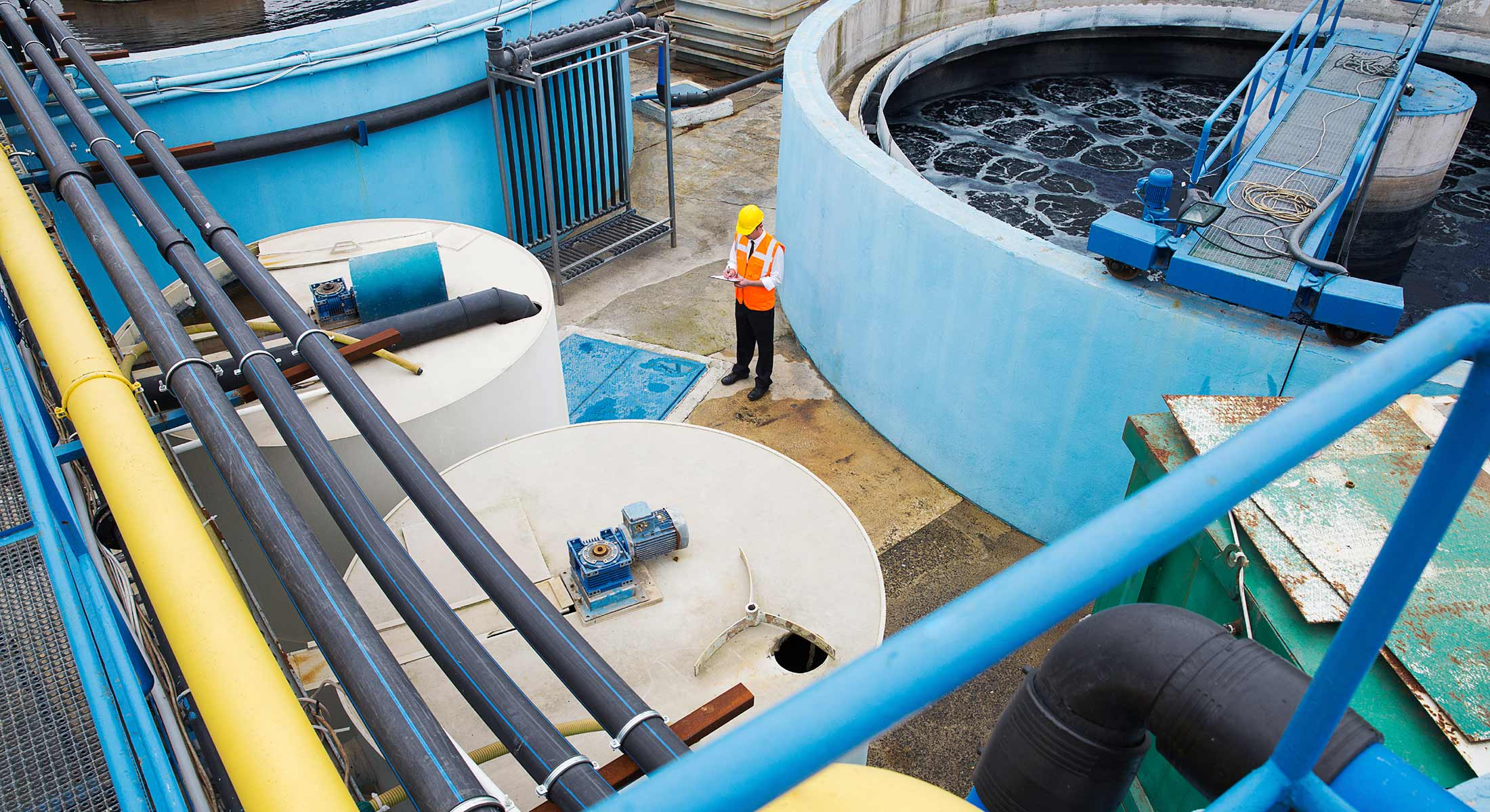locus_photo_water-utility-inspector-amid-tanks_2200x1200